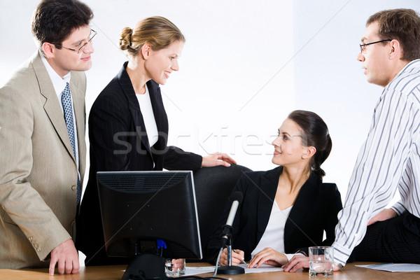 Negociações pessoas de negócios discutir perguntas reunião negócio Foto stock © pressmaster