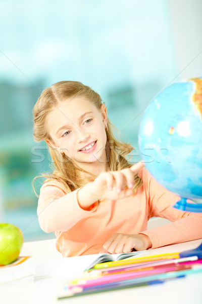 Stock photo: Pointing at globe