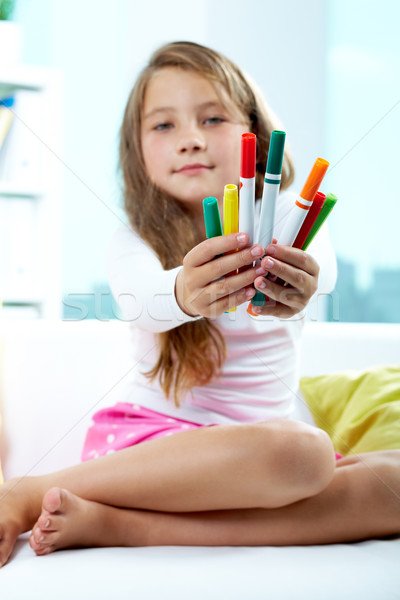 Girl giving crayons Stock photo © pressmaster