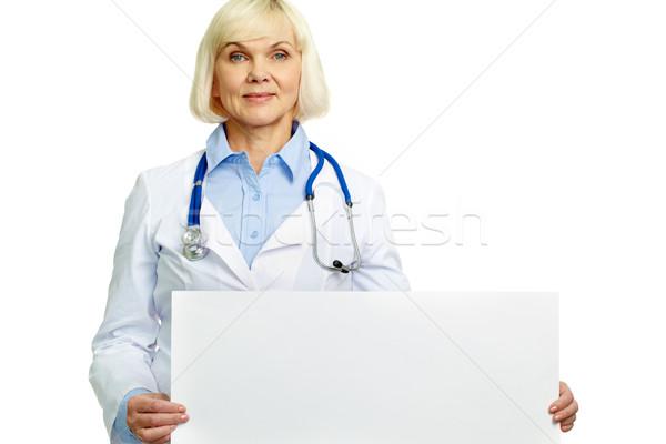医師 プラカード 笑みを浮かべて 女性 空っぽ ストックフォト © pressmaster