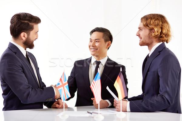 Stock fotó: Sikeres · megállapodás · kép · három · partnerek · tárgyalás