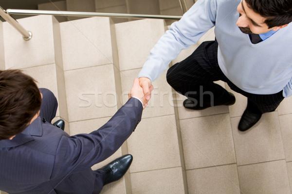 Stock fotó: Férfiak · fotó · kézfogás · üzletemberek · lépcsőház · üzlet