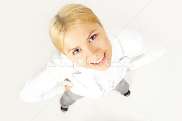 Spojrzeć powyżej widoku udany kobieta interesu patrząc Zdjęcia stock © pressmaster