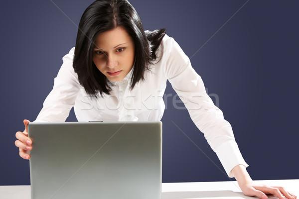 Interessante imagem atento empresária olhando laptop Foto stock © pressmaster