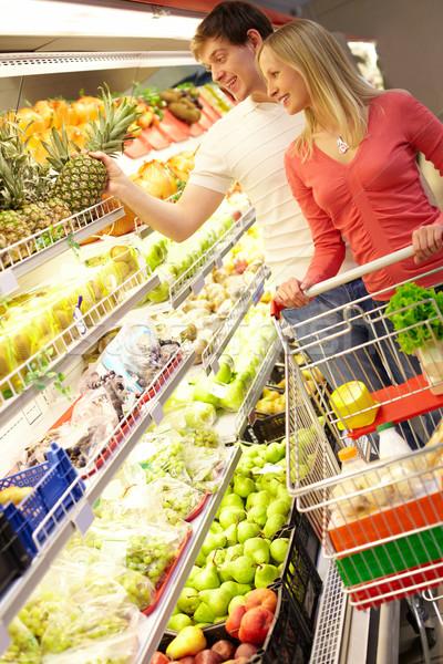 торговых фрукты портрет человека прикасаться ананаса Сток-фото © pressmaster