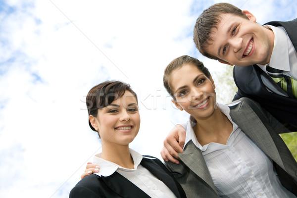 üzleti csoport portré mosolyog emberek néz kamera Stock fotó © pressmaster