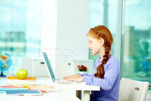 Stock photo: Typing pupil