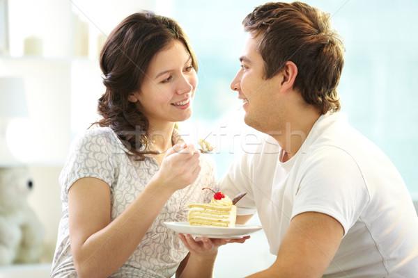 Couple eating cake Stock photo © pressmaster