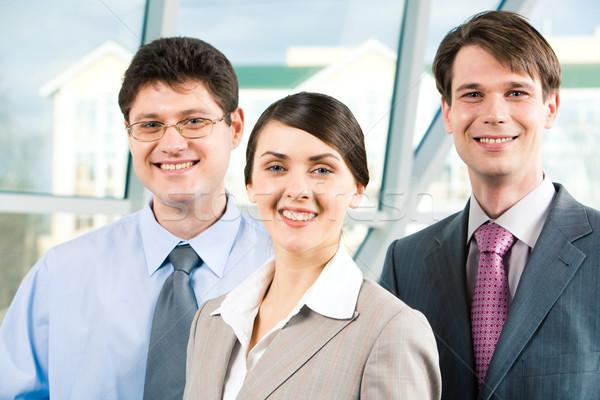 üzleti csoport portré mosolyog üzletemberek néz kamera Stock fotó © pressmaster