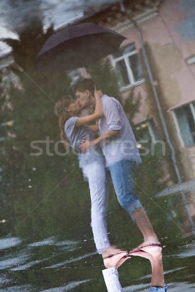 Réflexion image homme femme baiser Photo stock © pressmaster