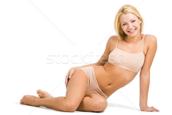 Saludable femenino foto mujer bonita sesión piso Foto stock © pressmaster