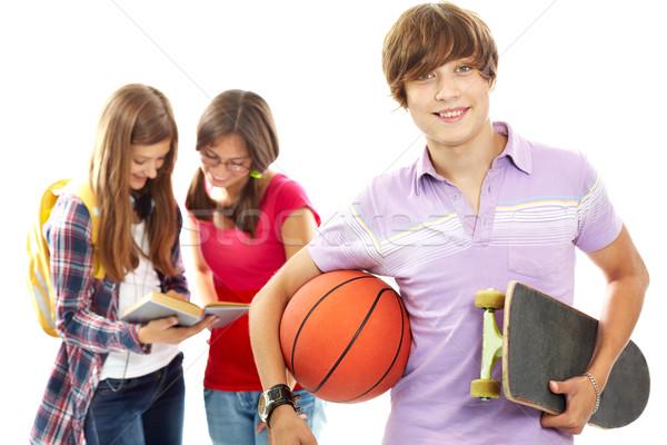 активный подростку скейтборде мяча глядя камеры Сток-фото © pressmaster