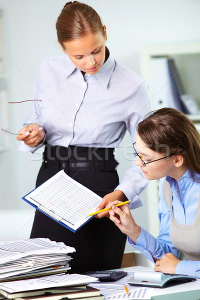 Looking at paper Stock photo © pressmaster
