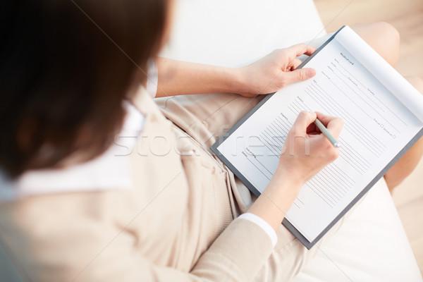 Médico registro feminino conselheiro escrita para baixo Foto stock © pressmaster