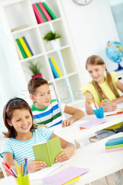 дети урок портрет девушки глядя блокнот Сток-фото © pressmaster