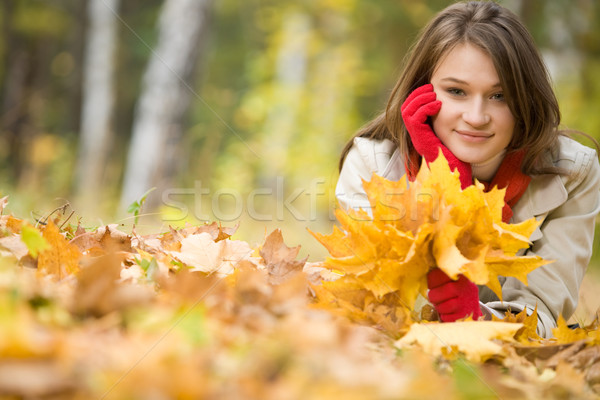 Girl upon leafed ground Stock photo © pressmaster