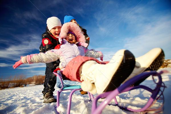 Riding on sledge Stock photo © pressmaster