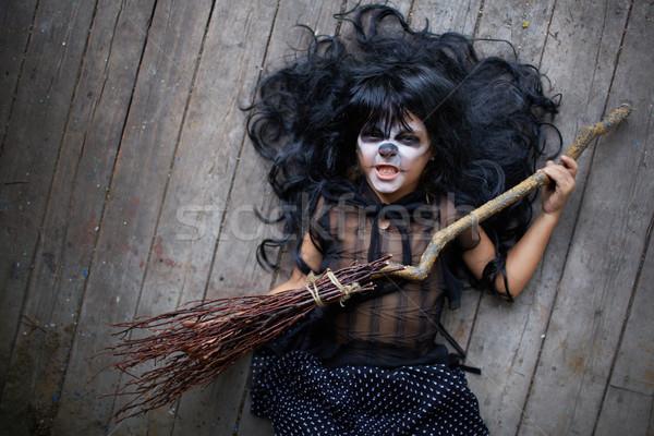 Girl with broom Stock photo © pressmaster