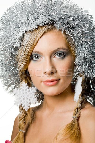 Charmant vrouw jonge ingericht sneeuwvlokken naar Stockfoto © pressmaster