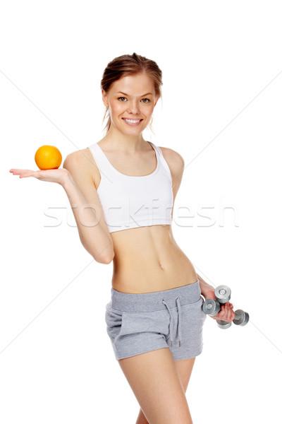 Egészséges étrend portré karcsú fiatal nő narancs súlyzók Stock fotó © pressmaster