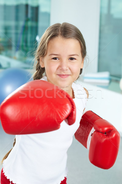 Fille gants de boxe portrait joli gymnase enfant Photo stock © pressmaster