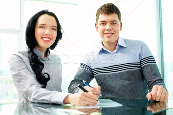 Сток-фото: партнеры · бизнеса · два · молодые · люди · подписания · договор