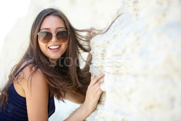 Bonheur brunette lunettes de soleil calcaire Photo stock © pressmaster