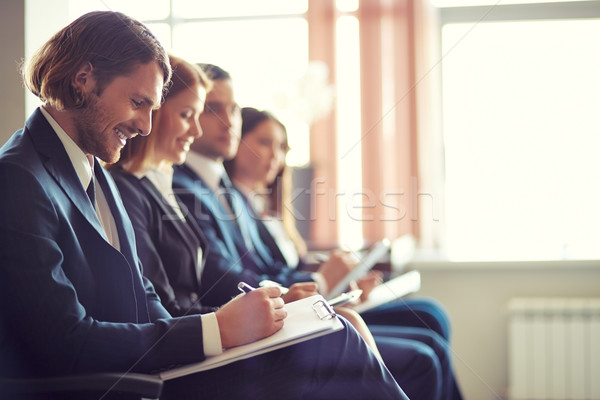 Piśmie wykład rząd ludzi biznesu zauważa Zdjęcia stock © pressmaster