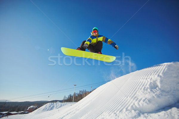 Sportsman snowboarding Stock photo © pressmaster