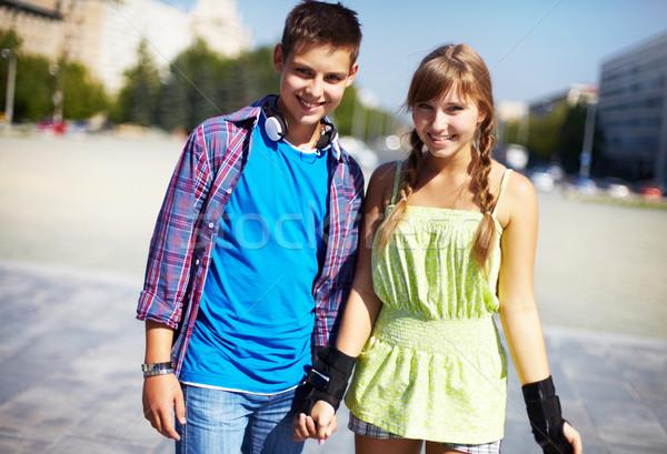 Fiatalos pár kettő boldog néz kamera Stock fotó © pressmaster