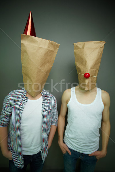 Guys in paper bags Stock photo © pressmaster