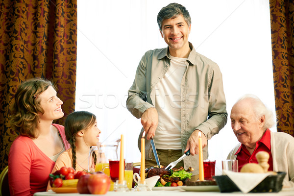Together at festive table Stock photo © pressmaster