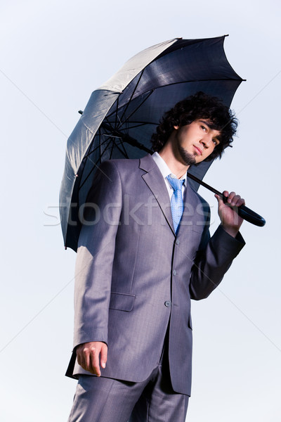 Hombre paraguas retrato grave empresario pie Foto stock © pressmaster