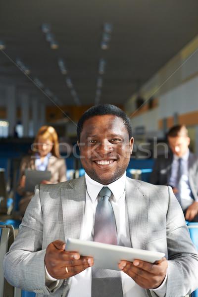 Stockfoto: Man · touchpad · jonge · zakenman · naar · camera