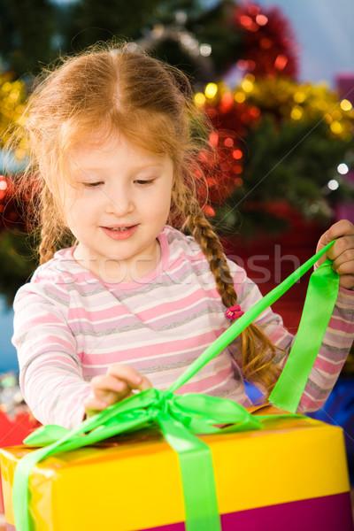 Unwrapping present Stock photo © pressmaster