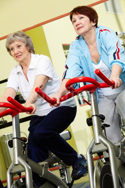 Tornaterem kettő aktív idős nők testmozgás Stock fotó © pressmaster