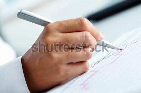 Writing review Stock photo © pressmaster