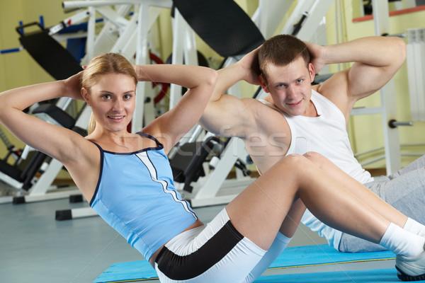 Workout in gym Stock photo © pressmaster