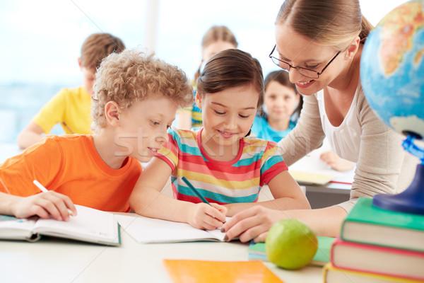 élèves leçon portrait diligent écolière dessin Photo stock © pressmaster