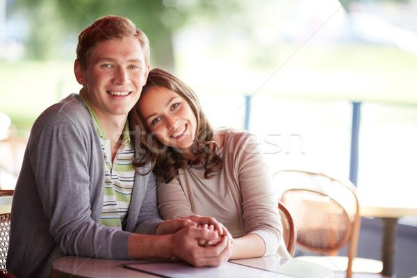 Affettuoso date felice ragazzo fidanzata seduta Foto d'archivio © pressmaster