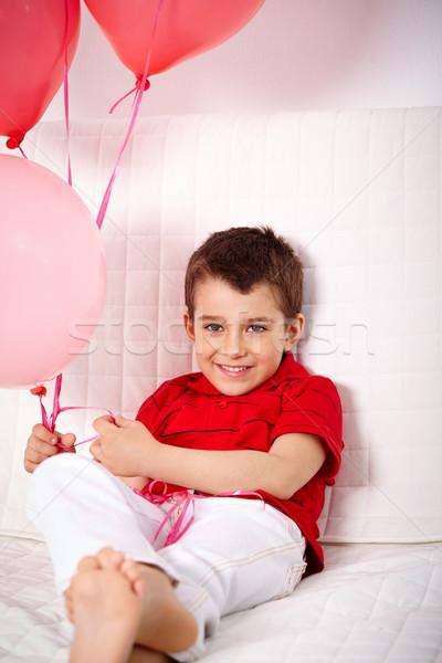 Chico globos retrato feliz relajante sofá Foto stock © pressmaster