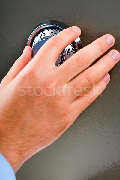 Serrure à combinaison Homme main sûr argent Photo stock © pressmaster