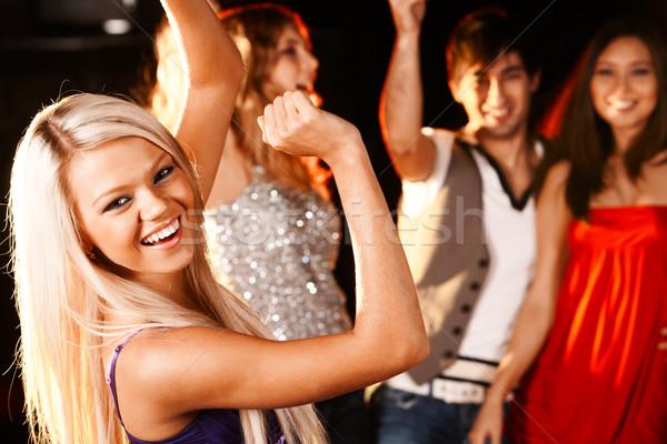 Tánc lány portré derűs buli barátok Stock fotó © pressmaster