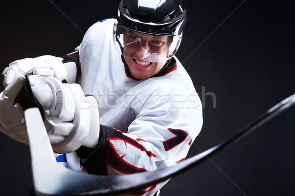Adversaire colère joueur pointant bâton noir Photo stock © pressmaster