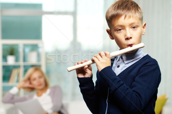 Young flute player Stock photo © pressmaster