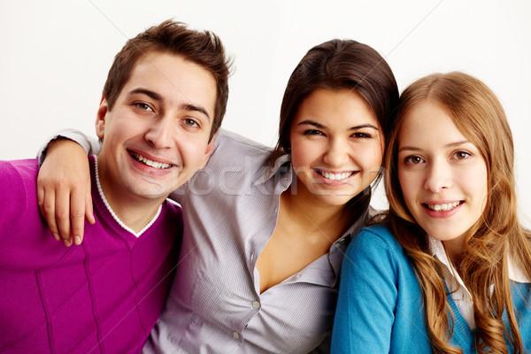 Gelukkig vrienden portret aantrekkelijk naar camera Stockfoto © pressmaster