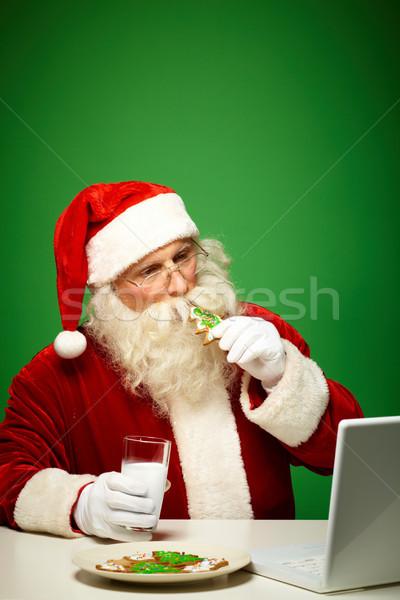 Looking through e-mail Stock photo © pressmaster