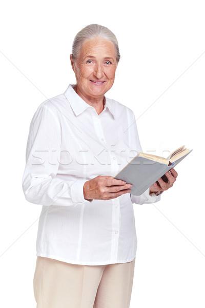 Nagyi könyv portré idős női néz Stock fotó © pressmaster
