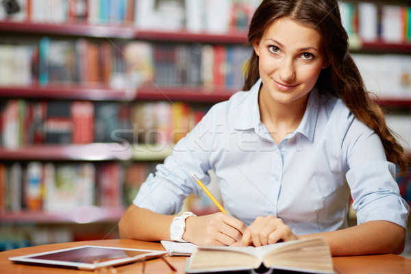Making notes in library Stock photo © pressmaster