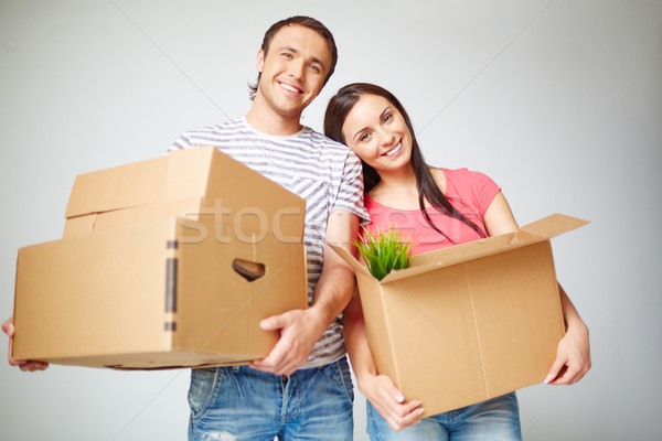 Couple with boxes Stock photo © pressmaster